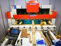 Yuhuan Sheng Hongfa CNC 8-spindle wood engraving machine which specialize in engraving human statue, Buddha statue, handicrafts. NONTHABURI, THAILAND – stock images