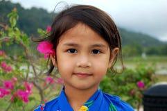 Yukata Girl. Portrait of a girl wearing Japanese yukata and bougainvillea flower at her ear Royalty Free Stock Photos