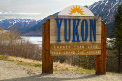 Yukon Border Sign. A sign indicating the Yukon border as you approach from Alaska, USA.  This can be found on the road from Skagway to Carcross Caribou Crossing Stock Image