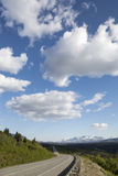 Yukon Highway with Clouds Stock Images