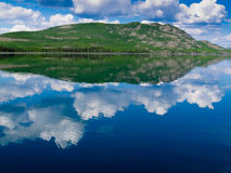 Yukon wilderness reflected on calm lake Stock Photography