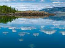 Yukon wilderness reflected on calm lake Royalty Free Stock Photo