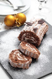 Yule log cake on a Christmas table Royalty Free Stock Photography