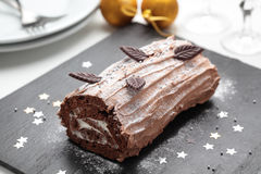 Yule log cake on a Christmas table Royalty Free Stock Photo