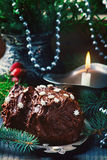 Yule log on a Christmas background. Royalty Free Stock Photo