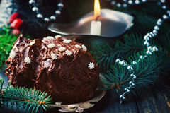 Yule log on a Christmas background. Stock Photos