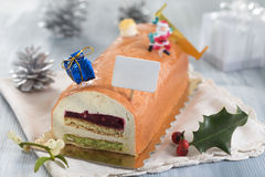 Yule log of white chocolate mousse, stuffed with raspberry puree Royalty Free Stock Photos