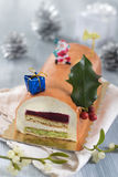 Yule log of white chocolate mousse, stuffed with raspberry Stock Photography