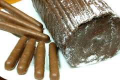 Yulelog and chocolate finger biscuits Royalty Free Stock Image