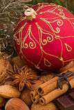 Yuletide. Christmas bauble with nuts and cinnamon as closeup Stock Photography