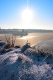 Yuletide ballybunion castle and beach in snow. A seasonal snow covered view of atlantic ocean and ballybunion castle beach and cliffs on a frosty snow covered Royalty Free Stock Image