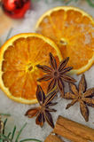Yuletide spices and orange slices royalty free stock photos