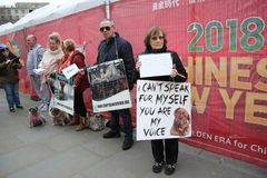 Yulin dog festival protestors Chinese New Year, year of the dog London, February 2017. Royalty Free Stock Photography