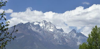The Yulong Jokul. Is 5596 meters above sea level.It's 15 kilometers north to Lijiang。The foot of the mountain reach to the Jinsha River. Still heavily Stock Image