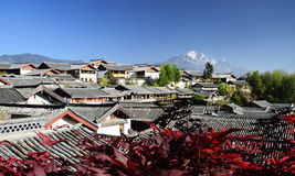 The Yulong Jokul and Old Town of Lijiang. The Yulong Jokul is 5596 meters above sea level.It's 15 kilometers north to Old Town of Lijiang。The foot of the Stock Photo