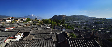 The Yulong Jokul and Old Town of Lijiang. The Yulong Jokul is 5596 meters above sea level.It's 15 kilometers north to Old Town of Lijiang。The foot of the Royalty Free Stock Photo