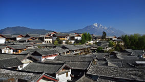 The Yulong Jokul and Old Town of Lijiang. The Yulong Jokul is 5596 meters above sea level.It's 15 kilometers north to Old Town of Lijiang。The foot of the Royalty Free Stock Photos