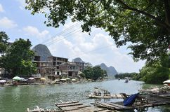 Yulong River Scenic Area in Yangshuo. Asian Chinese Guangxi Guilin Yangshuo in the beautiful scenery of the dragon river, clear sky and in the river boat Royalty Free Stock Photos