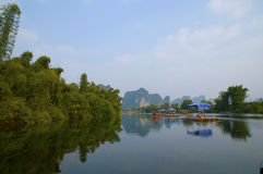 Yulong River in Yangshuo. Yulong River landscape in Yangshuo Guilin China. This photo was taken on a drifting boat on Yulong River Royalty Free Stock Image