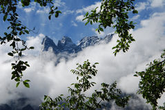 Yulong snow mountain in west china. Yulong snow mountain in Lijiang,west China's Yunnan  province,which is one of  the most well-known mountains in China,and a Stock Photography