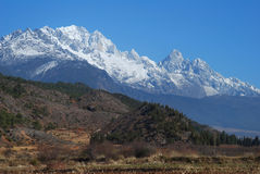 Yulong snow mountain in west china. Yulong snow mountain in Lijiang,west China's Yunnan  province,which is one of  the most well-known mountains in China,and a Royalty Free Stock Image