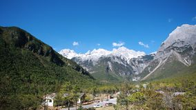 Yulong Snowmountain. Jade Dragon Snow Mountain is a snow mountain group in Lijiang, Yunnan, China. It is about 15 kilometers north of Lijiang, with a total stock images
