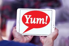 Yum! Brands logo. Logo of Yum! Brands on samsung tablet . is an American fast food company. A Fortune 500 corporation, Yum! operates the brands Taco Bell, KFC Stock Photo