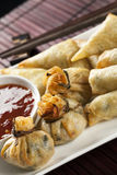 Yum Cha. Fried wontons and spring rolls with chili sauce royalty free stock photography