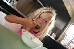 Yum Yum. Young girl eating breakfast Stock Photo