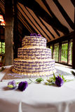 Yum yum. A three-tiered wedding cake with flowers and decorations Royalty Free Stock Photography