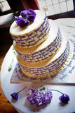 Yum yum wedding cake. A three-tiered wedding cake with flowers and decorations Royalty Free Stock Images