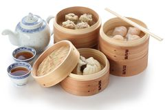 Yumcha, dim sum in bamboo steamer stock images
