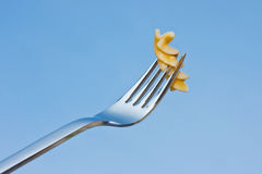 Yummi. Cooked whole grain noodle on a fork Royalty Free Stock Image