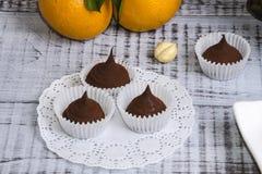 Yummy помадки шоколада с фундуком и tangerines Стоковые Изображения