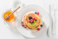 Yummy american pancakes with blueberries and raspberries. Closeup of yummy american pancakes with blueberries and raspberries Stock Images