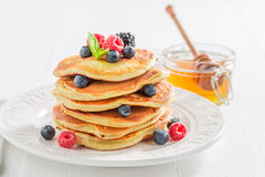 Yummy american pancakes for breakfast in the morning. Closeup of yummy american pancakes for breakfast in the morning Royalty Free Stock Photography