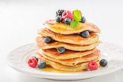 Yummy american pancakes with fresh berry fruits. Closeup of yummy american pancakes with fresh berry fruits Stock Image