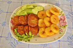 Yummy appitizer in the plate. Fried Fish-paste balls with vegetables in the plate Royalty Free Stock Image