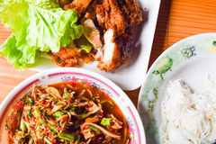 Yummy authentic Local thai food Somtum and Gaiyang, Papaya spicy salad and griled chicken with purple orchid image decorated Stock Photos