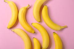 Yummy bananas on background. Yummy bananas on color background Royalty Free Stock Photography