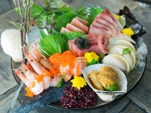 Big Bowl of Japanese Sashimi. Yummy big bowl sashimi and Sushi Menu, Sliced Raw Fish, Tuna, Salmon, Mackeral, Uni and Scallop Stock Image