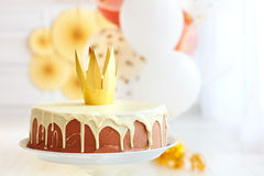 Yummy birthday cake with golden crown on baby party background Stock Photo