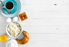 Yummy breakfast, additional text space left, topview. Yummy breakfast with cottage cheese and croissant, additional text space left on the side, topview stock photography