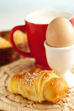 yummy breakfast with croissants and eggs Royalty Free Stock Photo
