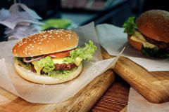 Yummy burger. serving cheeseburger or hamburger with salad and t Stock Image