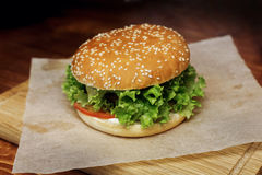 Yummy burger. serving cheeseburger or hamburger with salad and t Royalty Free Stock Image