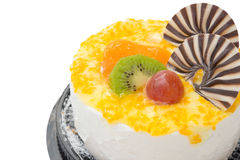 Yummy cake on white with grape orange kiwifruit and chocolate on top Stock Image