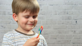 Yummy candy in boy`s hand Royalty Free Stock Images