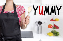 Yummy chef holding wooden spoon background Royalty Free Stock Photos