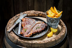 Yummy chips and tbone steak with herbs and salt Stock Images